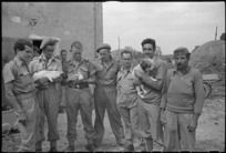 New Zealand and Greek soldiers at a farm in Italy, during World War 2