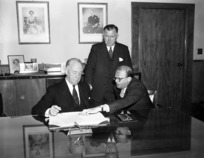 Prime Minister, Sidney Holland and Minister of Social Security, Eric Halstead, with Australian representative, sign Social Security Agreement with Australia, December 1955.