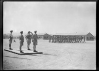 Members of the New Zealand Artillery on parade, marching past Brigadier C E Weir in Maadi, Egypt, during World War 2 - Photograph taken by George Kaye