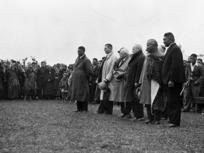 Tonga Mahuta, Joseph Gordon Coates, Henry Edmund Holland, Frank Langstone, Sir Apirana Ngata and Tumate Mahuta at the graveside of the Maori King Te Rata