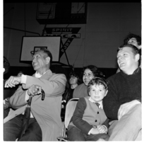 Spectators at a wrestling match, YMCA Hall, Pitt Street, and fisheries, Freemans Bay, Auckland