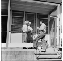 Visiting salesman at pensioners flats, Beresford Street area, Ponsonby, Auckland