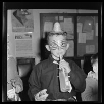 Unidentified National Airways Corporation Orphan drinking his soda