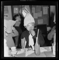 Unidentified National Airways Corporation Orphan wearing a party mask and hat