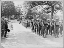 Winston Churchill taking the salute from D Company of 28 (Maori) Battalion, England