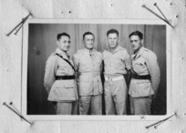 Group portrait of Lieutenant H M Mitchell and Second Lieutenants W Wordley, J Smith, and M Ngarimu