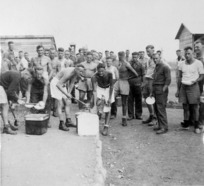 Prisoners of war at Camp 57, Gruppignano, Italy, lining up for food