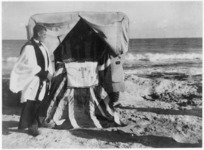Padre Holland by an improvised altar on the beach at Nofilia, Tripolitania, Libya, during a Christmas Day service for World War 2 New Zealand troops - Photograph taken by C A Churchill