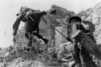 Two soldiers, on the battlefront at Cassino, Italy, during manoeuvres