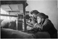 New Zealand soldiers with machine gun, at Faenza, Italy, during World War II - Photograph taken by George Kaye