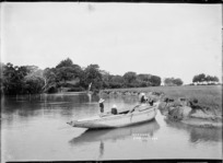 Boys playing on a boat at Deep Creek, Torbay, Auckland