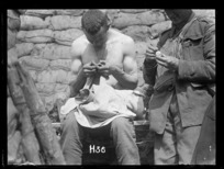 The search - a World War I soldier looking for lice