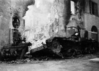 Wrecked German tank amongst ruined buildings, Medicina, Italy, during world War II