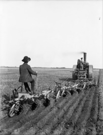 Ploughing, using a traction engine and 3 triple furrow ploughs