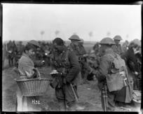 William Marsters buying cakes from a vendor in Belgium