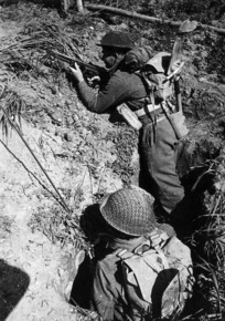 Two New Zealand soldiers, in a slit trench during World War II, Senio area, Italy