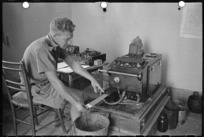World War II soldier from New Zealand, L N Richards, operating sound ranging equipment in a forward area during the battle for Florence, Italy - Photograph taken by George Kaye