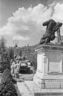 World War II soldiers from New Zealand at Castiglione, Italy, by a war memorial for Italian soldiers who fell during World War I - Photograph taken by George Kaye