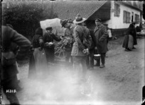New Zealand soldiers buying vegetables in a French village