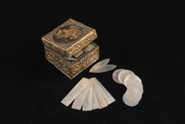 Mansfield, Katherine 1888-1923 (Collector) :[Mother-of-pearl fish and other counters, being contents of ornamental square Italian box. Late eighteenth century to early twentieth century?]