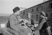 World War II soldiers of Maori Battalion, and their dog, at Forli, Italy - Photograph taken by George Frederick Kaye
