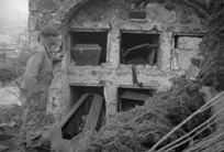 View of vaults at a cemetery that were damaged by shell fire in Italy during World War II