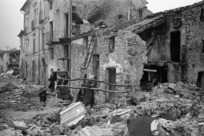 People searching among the ruins of the village of Gessopalena, Italy
