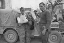 Wounded German prisoner entering a New Zealand Red Cross truck, Sesto Imolese, Italy