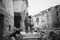 Children standing atop ruins of the demolished village of Gessopalena, Italy
