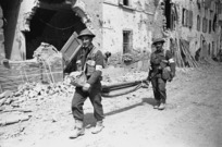 Kaye, George, 1914- : NZ stretcher bearers arrive in the Italian town of Barbiano shortly after its capture by NZ troops
