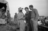 South African soldier asking two New Zealand soldiers for information, Italy