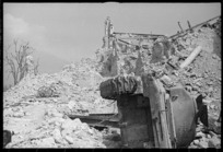 Cassino, Italy, on the day it fell to the Allies, with town ruins and overturned tank - Photograph taken by George Kaye