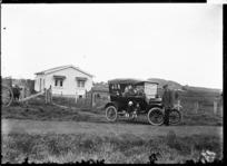 Model T Ford outside a farm house