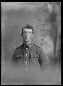 Studio upper torso portrait of unidentified World War One soldier with 'C10' collar badges [C Squadron, 10th Reinforcements?], Christchurch