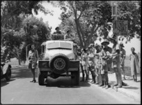 New Zealand soldiers on leave standing at official hitch hiking point in Cairo, World War II - Photograph taken by G Kaye