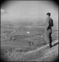 From fortress of Lucera, C Hoskins looks over valley where NZ Division camped, Italy, World War II - Photograph taken by George Kaye