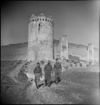 NZ soldiers beneath tower of the fortress of Lucera, Italy, World War II - Photograph taken by George Kaye