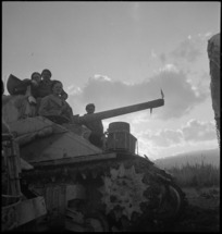Men of NZ tank formation move towards the bridge across the Sangro in Italy, World War II - Photograph taken by George Kaye
