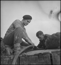 F J Humphries and K D Leydon examining depth of water in water storage cart in Italy, World War II - Photograph taken by George Kaye