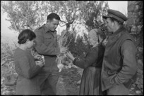 L G Bell and M D Elias in conversation with Italian peasant woman, World War II - Photograph taken by George Kaye