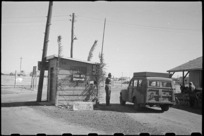 Provost Post at entrance to Maadi Camp decorated with Christmas Greetings, Egypt, World War II - Photograph taken by George Bull