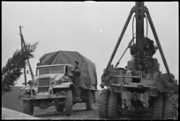 Tyre chains a necessity to enable heavy vehicles of NZ Divison to negotiate muddy roads on the Italian Front, World War II - Photograph taken by George Kaye