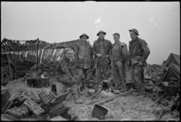 Men of New Zealand Artillery boil billy in wet and muddy surroundings on Christmas Eve afternoon, Italian Front, World War II - Photograph taken by George Kaye