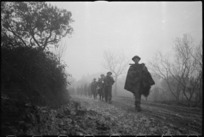 NZ Infantry formation making its way through mist and mud to the Italian Front Line on Christmas Eve, World War II - Photograph taken by George Kaye