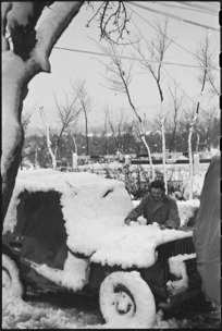 Jeep covered in snow on New Years Day, Italian Front, World War II - Photograph taken by George Kaye