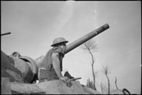 New Zealander A F Hare emerges from drivers compartment of a Sherman tank on the Italian Front, World War II - Photograph taken by George Kaye