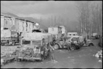Drivers of New Zealand Division vehicles washing their trucks in Alife, Italy, during World War II - Photograph taken by George Kaye