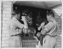 Two soldiers taking refreshment at the Nathaniya Leave Camp, Palestine, World War II