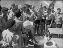 Lemonade refreshments from a tub at 19 NZ Armoured Regiment swimming sports, Cairo - Photograph taken by G Kaye