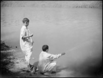 Wallads fishing in a canal, Egypt - Photograph taken by George Kaye